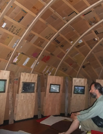 The roof and curved wall is covered in cardboard